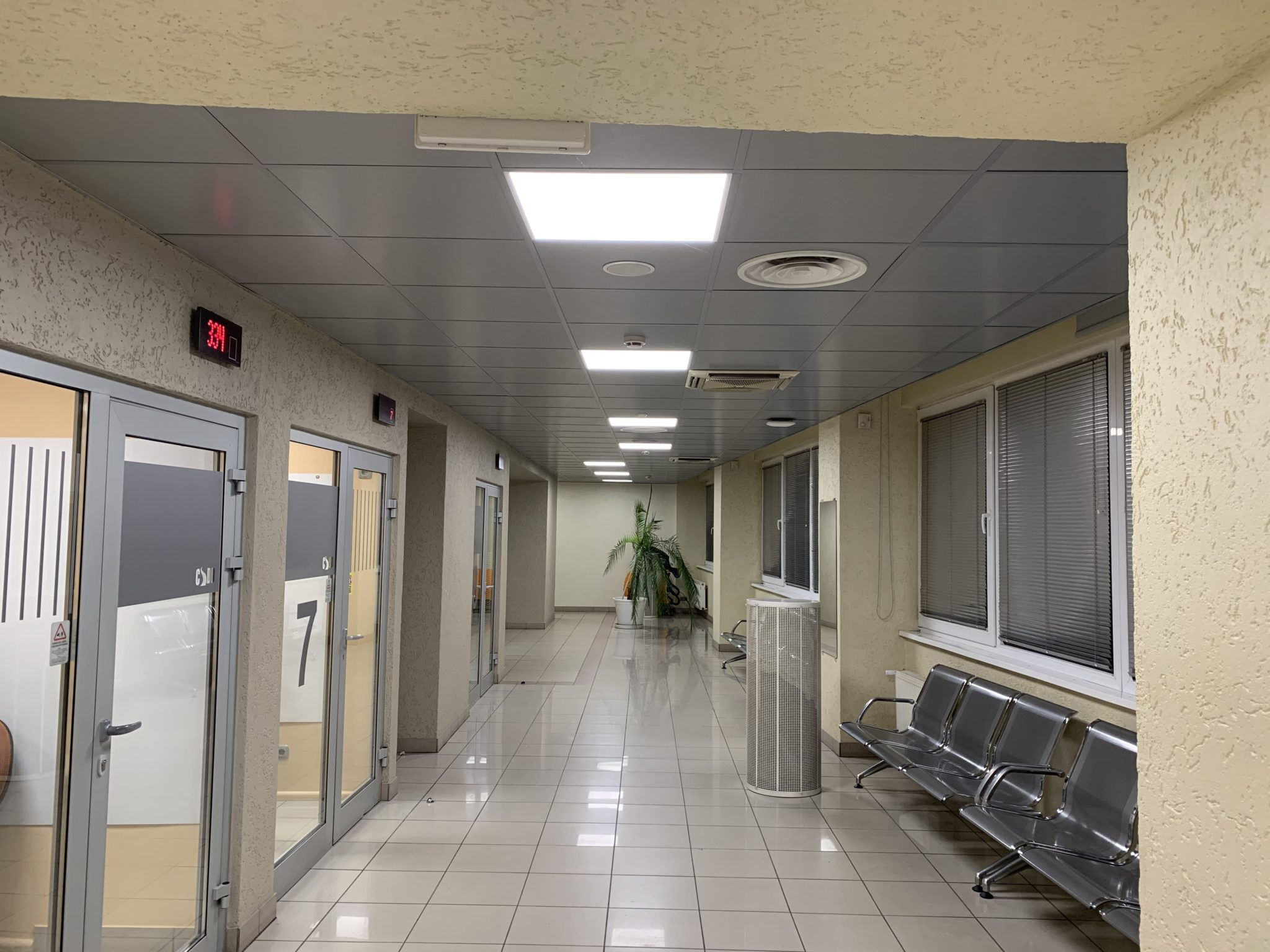 Hallway iluminated with Philips Led surface-mounted luminaries at CSSD customer service center