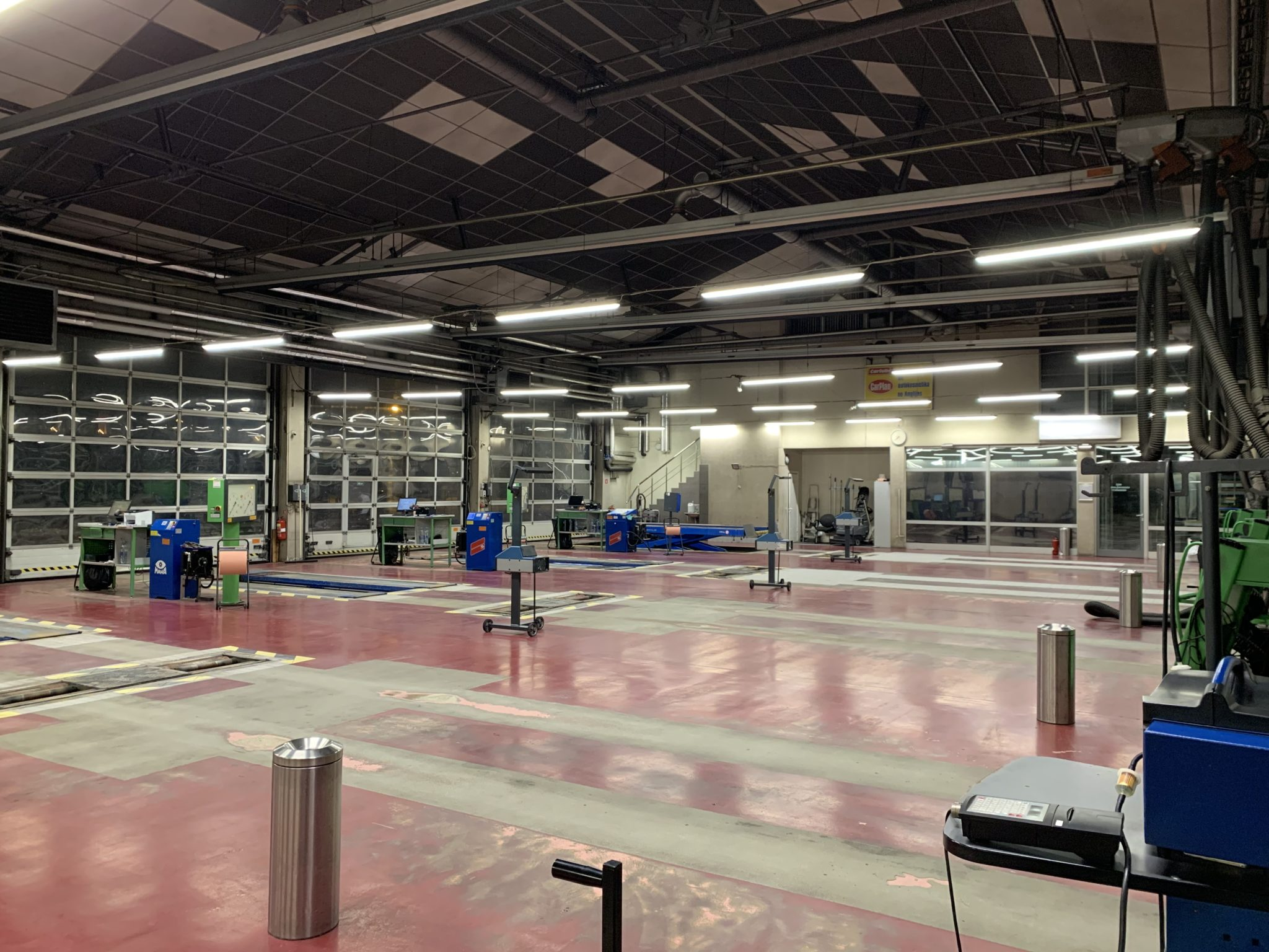 Lines of Philips Led luminaires iluminating techincal inspection station